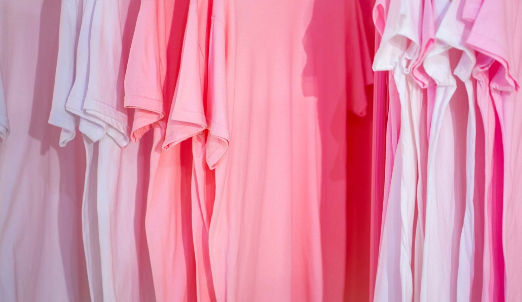 Row of pink t-shirts hanging